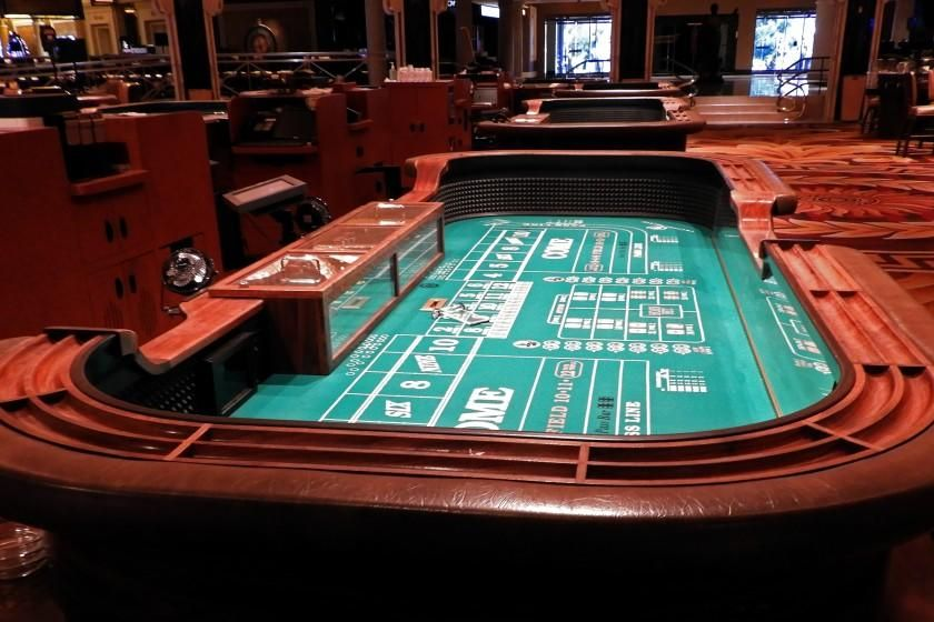 "The conviviality and excitement of a crowd craps table will be subdued when Caesars Palace Las Vegas reopens. State regulators will limit craps games to six players at each table. <span class=""copyright"">(Jay Jones)</span>"